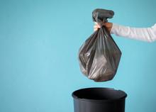 Hand Holding Garbage In Plasti...