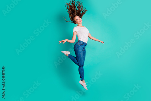Full length body size view of her she nice-looking attractive lovely winsome sweet slim fit thin cheerful wavy-haired lady strolling having fun pleasure isolated on bright vivid shine blue background
