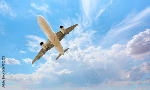 Montage in der Fensternische Flugzeug White passenger airplane in the clouds - Travel by air transport M