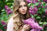 Beautiful girl in lilac Garden. Girl with lilac flowers in springtime. Gardening. - 269503241