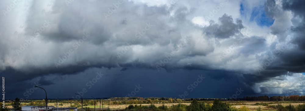 Fototapeta Panorama of dramatic stormy clouds over the village