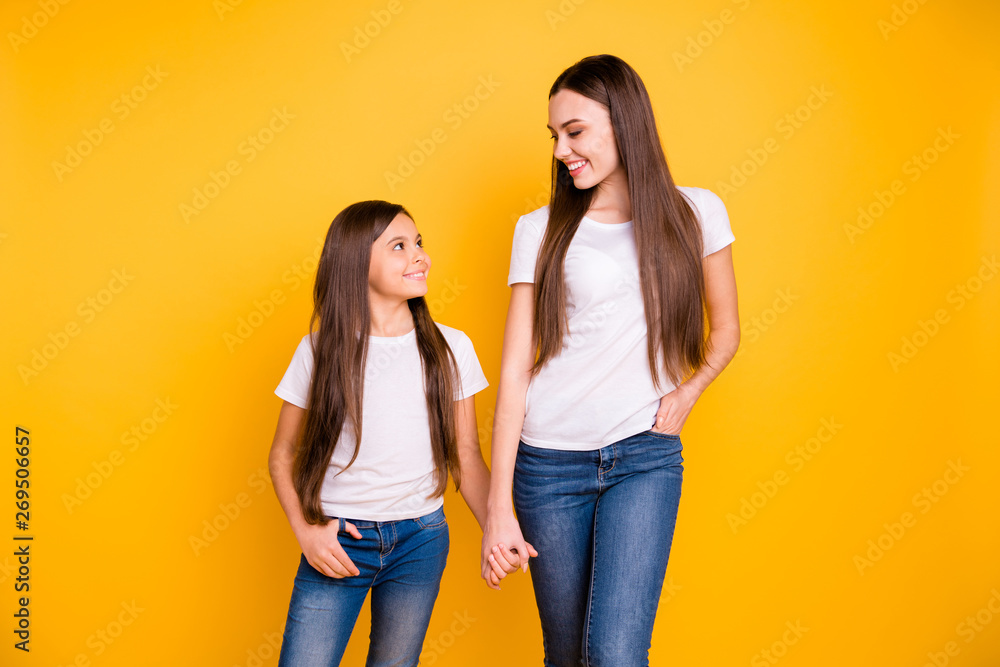 Fototapety, obrazy: Close up photo two beautiful her she diversity lady different age hold hands arms go secondary highschool speak communicate wear casual white t-shirts jeans denim isolated yellow bright background