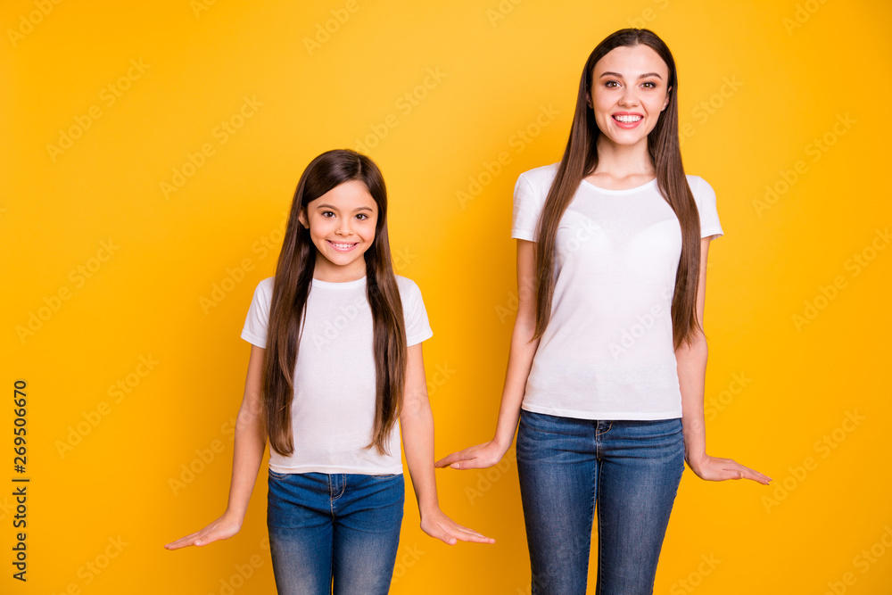 Fototapety, obrazy: Close up photo two beautiful her she diversity lady different age buddies hold hands arms sides attractive appearance wear casual white t-shirts jeans denim clothes isolated yellow bright background