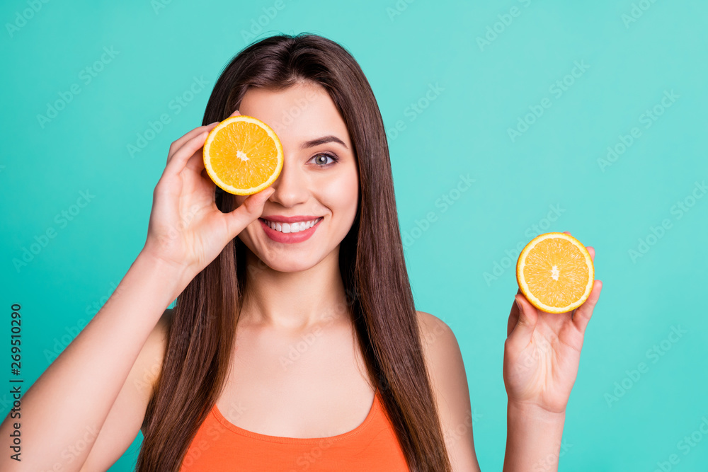 Fototapeta Close up photo beautiful amazing her she lady hold arms hide one eye citrus useful slices products advertising nutrition freshness wear casual orange tank-top isolated bright teal turquoise background