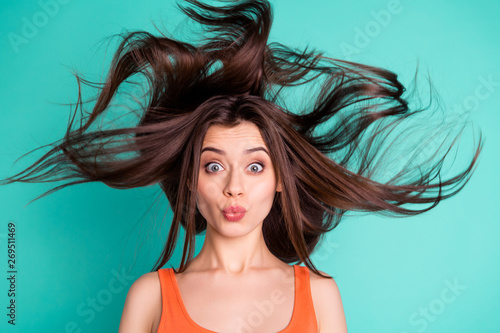 Close up photo amazing beautiful her she lady send air kisses friends weekend vacation wind blowing hair flight healthy condition wear casual orange tank-top isolated bright teal turquoise background