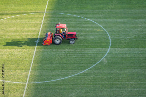 Man in tractor aerating a soccer field Canvas Print