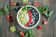 summer vegetarian breakfast bowl with fresh fruit and chia seeds for healthy eating