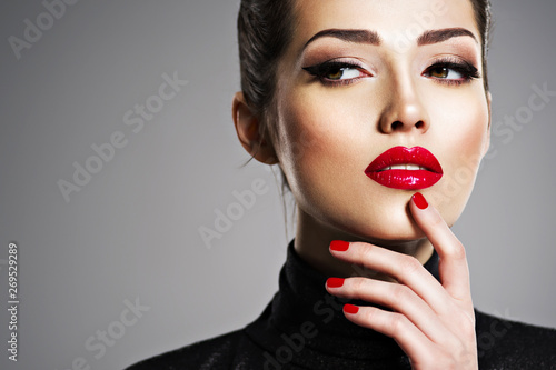 Fotografija Beautiful woman with bright make-up and red nails.