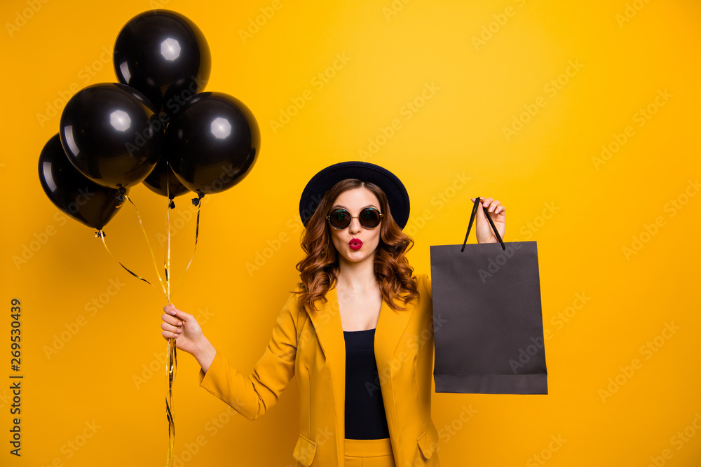 Fototapeta Close up photo beautiful she her lady vacation abroad send air kiss carry packs perfect look buy buyer present gift balloons sale discount wear specs formal-wear suit isolated yellow bright background