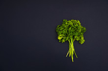 Parsley, Cherry Tomatoes And Lemon On The Black Background