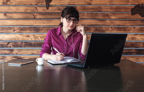 Businesswoman listening to music or a dictation Fotobehang