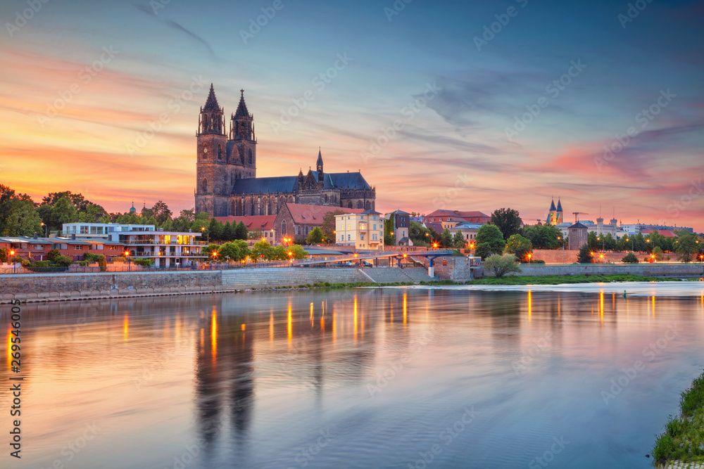 Fototapeta Magdeburg, Germany. Cityscape image of Magdeburg, Germany with reflection of the city in the Elbe river, during sunset.