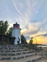 Lighthouse On The Lake Shore Sunset Sky