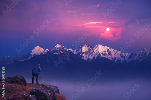 Photographer traveler take a picture of sunrise in mountains the Himalayas. Nepal