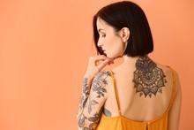 Beautiful Tattooed Woman On Co...
