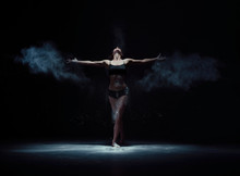 Graceful Woman Dancing In White Dust Cloud Shot