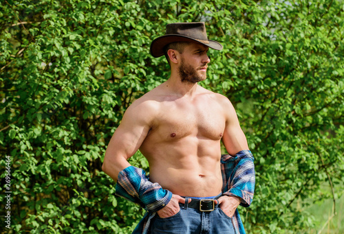 Fényképezés  Macho six packs torso wear rustic style clothes and cowboy hat
