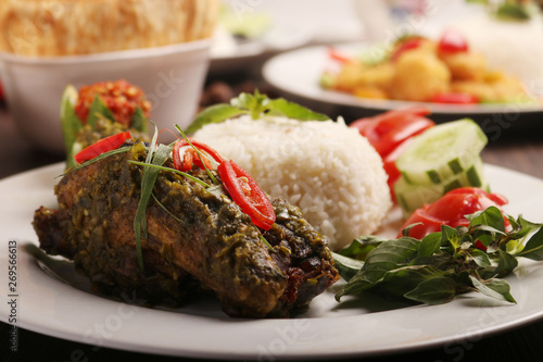 Photo Stands Ready meals fried chicken wrapped in green chili served with rice