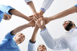 canvas print picture - Team of medical doctors putting hands together on white background, closeup. Unity concept