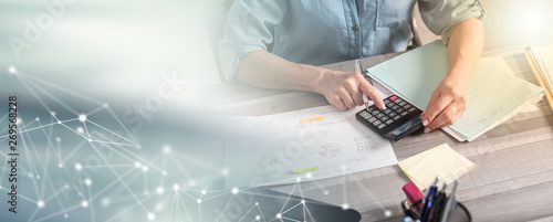 Female accountant using calculator; multiple exposure Canvas Print