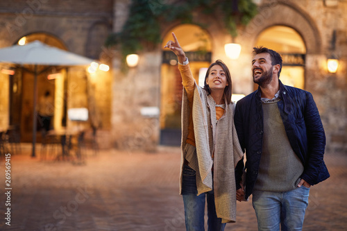 Obraz romantic evening walking of a loving couple on vacation. - fototapety do salonu