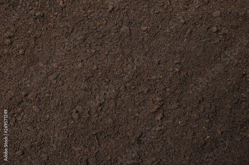 Fotografia Textured ground surface as background, top view. Fertile soil