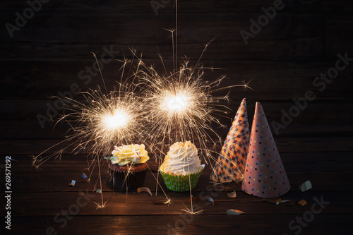 Fotomural birthday cake with sparkler on old wooden background