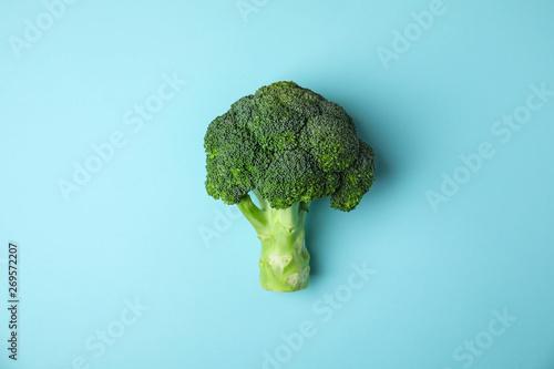 Stampa su Tela  Fresh green broccoli on color background, top view. Organic food