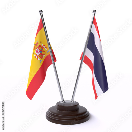 Fotografía  Spain and Thailand, two table flags isolated on white background