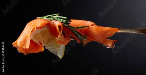 Obraz na plátně  Trout fillets, lemon slice and rosemary.