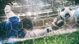 Fototapeta Sport - Goalkeeper catches the ball in the stadium during a football game