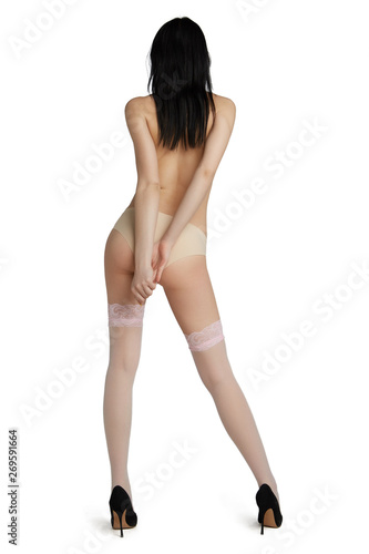 Fotografia, Obraz  Full length back view shot of lady, wearing pale pink nylon stockings with wide floral lace welt and black high heeled pumps