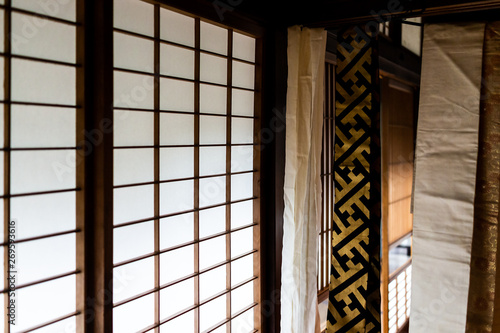 Traditional japanese house or ryokan with sliding paper door and light with arch Wallpaper Mural