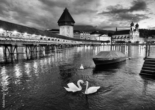 Chapel Bridge and Water Tower at night with swans on Lake Lucerne, Lucerne, Swit Poster Mural XXL