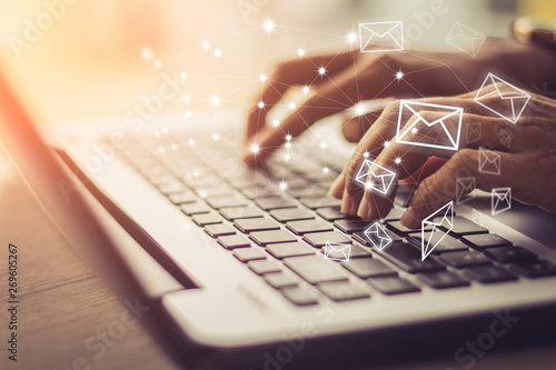 Cuadros en Lienzo Business woman hand using Laptop pc with email icon, Email concept