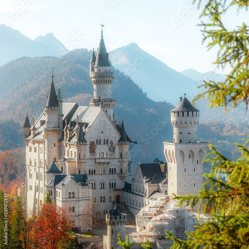 Foto auf Leinwand Pool Beautiful view of world-famous Neuschwanstein Castle with Alpine mountains on Background, under sunlit. Wonderful sunny landscape in Alps. near Fussen, southwest Bavaria, Germany.