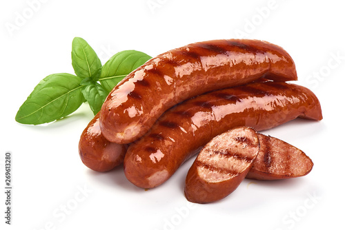 Fotografia Grilled bratwurst Pork Sausages with basil leaves, close-up, isolated on white b