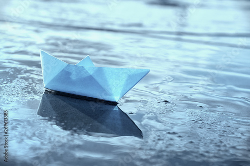 Fotografie, Obraz  Lonely blue paper boat in shallow water