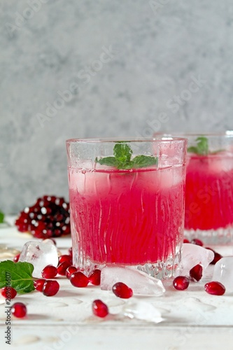 Fototapety, obrazy: Ripe pomegranate with juice on light background. Top view with copy space.