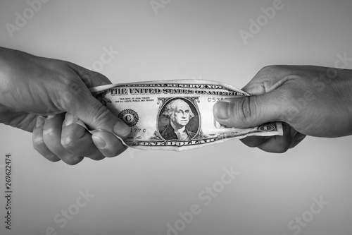 Fotografia, Obraz People fighting over money. Financial conflict concept.