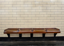 Bench And Tiles Wall In A Subway