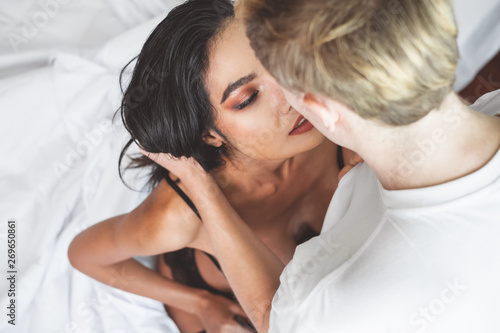 Fotografie, Obraz  Nude passionate couple having sex on white bed, love and sex concept