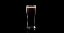 Craft Beer Brewed From Natural Malt And Barley In A Private Brewery On A Black Background