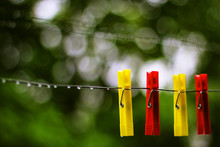Four Red And Yellow Pegs On Th...