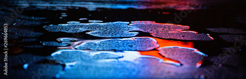 Wet asphalt, night scene of an empty street with a little reflection in the water, the night after the rain Fototapet