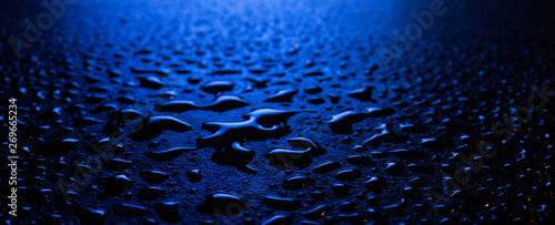Fotografia  Wet asphalt, night scene of an empty street with a little reflection in the water, the night after the rain