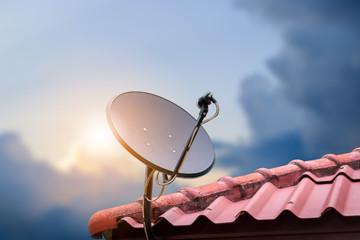 Communication concept with Satellite dish on sunshine background