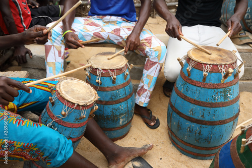 Close-up of a musician playing traditional drums on the beach in Accra, Ghana Canvas Print
