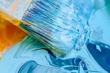 Mixing With A Brush Of Two Liquid Paints Dark Blue And Light Blue Colors. Coloring Acrylic Latex Paint. Paint Art Wide Brush In Blue Paint Close-up.