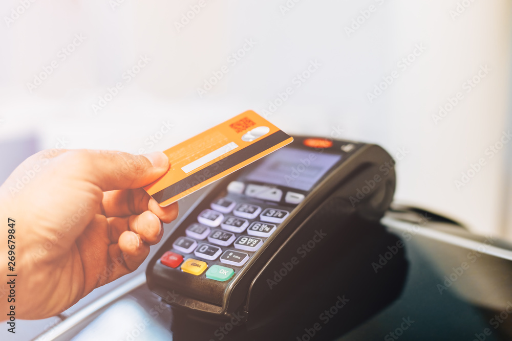 Fototapeta Payment terminal charging from a card